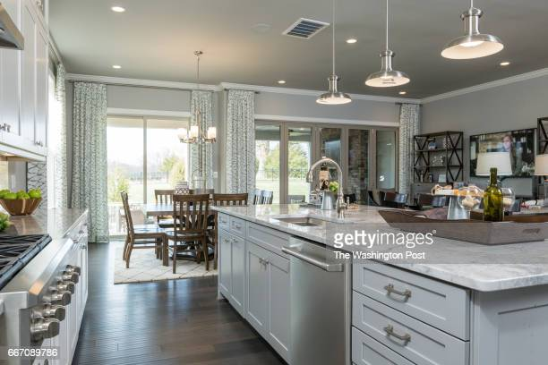 View of the Kitchen Island and Dining and Living area in the Tradition Model at Regency at Creekside on March 28 2017 in Gainesville Virginia