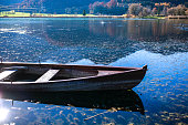 View of the lake with boat In the Bavarian Alps