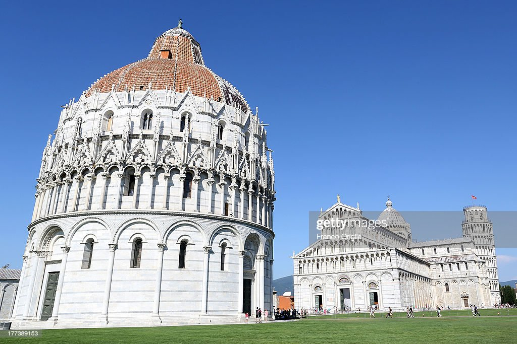 A view of the Leaning Tower of Pisa, Torre pendente di Pisa, campanile freestanding bell tower and the Cathedral of Santa Maria on August 10, 2013 in Pisa, Italy.