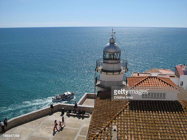 View of the lighthouse overlooking the sea on top of Peniscola Castellon Valencian Comunity Spain April 2012