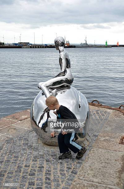 A view of The Little Merman Sculpture 'Han' in Denmark on June 12 2012 in Helsingor Denmark