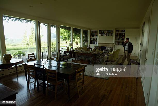 View of the living room of renowned science fiction writer Timothy Ferris who is shown making a phone call at his Rocky Hill Farm ranch–style house...