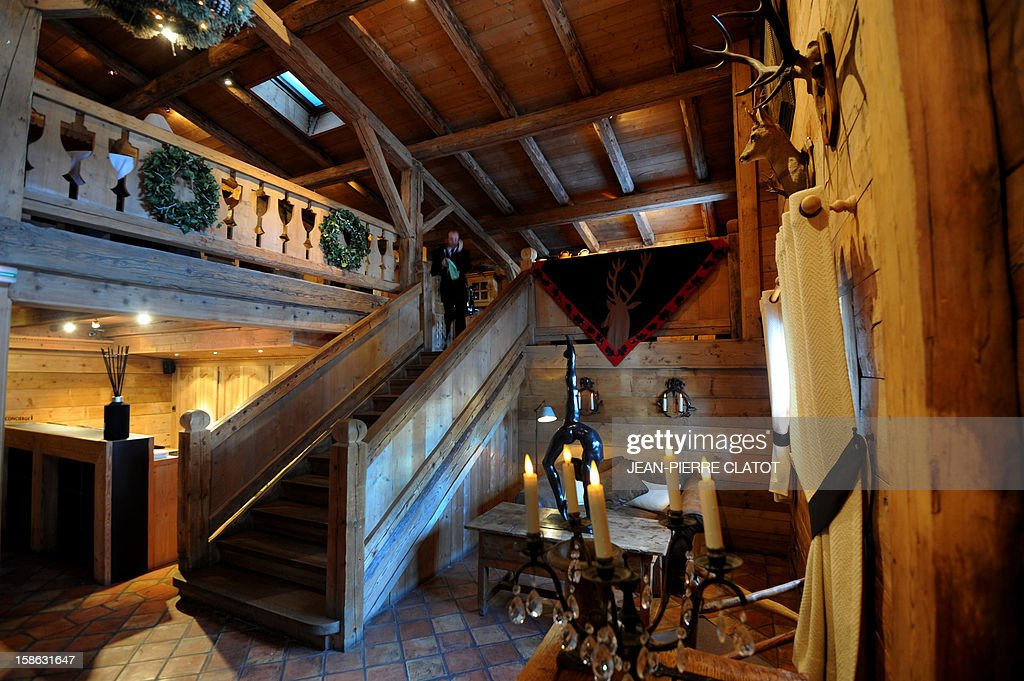 EMONET - A view of the lobby of the 'Fer à Cheval' five stars hotel taken on December 19, 2012 in the French luxury ski ressort of Megeve, French Alps. AFP PHOTO / JEAN-PIERRE CLATOT
