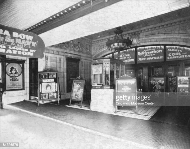 View of the lobby of the Palace Theater located on Cincinnati's 6th and Vine Streets 1930 Various signs tout the newly installed air conditioning...