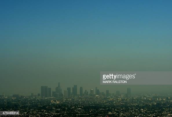 A view of the Los Angeles city skyline as heavy smog shrouds the city in California on May 31 2015 AFP PHOTO/ MARK RALSTON