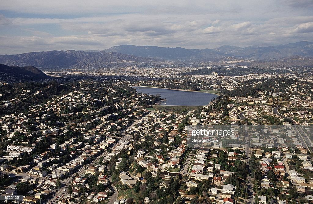 A view of the Los Feliz District looking toward Glendale and the San Gabriel Mountains is seen in this 1991 Los Angeles California aerial photograph