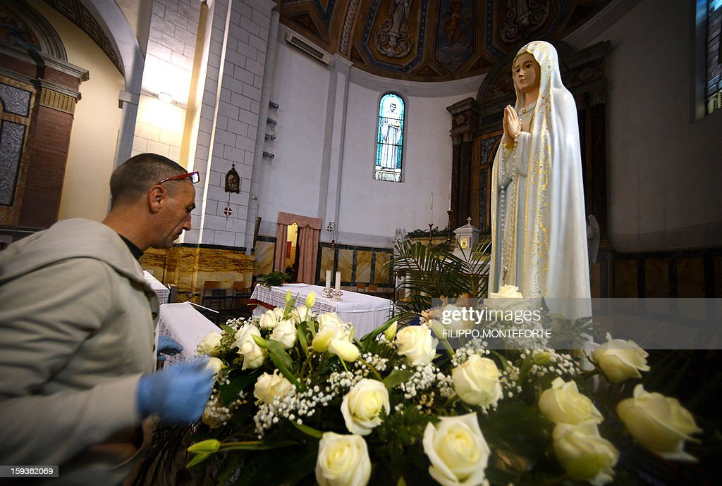 A view of the Madonna statue found onboard the Costa Concordia cruise ship which is now on the altar of the San Lorenzo and San Massiniliano al Porto church in the Italian island of Giglio on January 11, 2013. A year on from the Costa Concordia tragedy in which 32 people lost their lives, the giant cruise ship still lies keeled over on an Italian island and its captain Francesco Schettino has become a global figure of mockery. Italy on Friday extended a series of emergency powers to deal with the removal of the Costa Concordia cruise ship wreck amid a row over delays in the salvage operation a year after the disaster. AFP PHOTO / FILIPPO MONTEFORTE