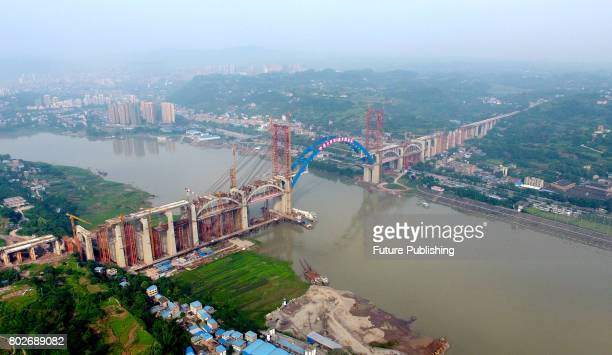 A view of the main arch of a bridge under construction on June 28 2017 in Yibin China The doubledecker bridge with a 336meter span across Yangtze...