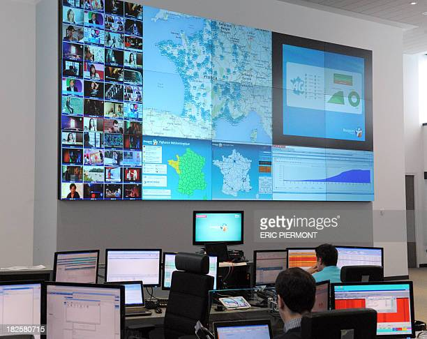 View of the main control room at French mobile telecommunications operator Bouygues Telecom's monitoring center in Meudon near Paris as the operator...