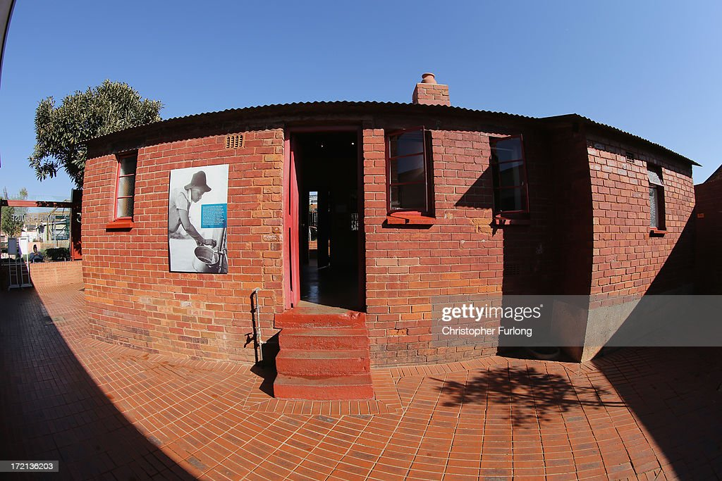 A view of the 'Mandela House' museum at 8115 in Vilakazi Street in the Orlando West section of Soweto Township on July 2, 2013 in Soweto, Johannesburg, South Africa. 8115 is the location of the first house owned by former South African President Nelson Mandela where he lived for 44 years from 1946 to 1990. The 'Mandela House', now a museum is managed by the Soweto Heritage Trust which has seen an increase in vistors both local and international since Mandela was hospitalized with a lung infection on June 8, 2013 and still remains in a critcal condition.