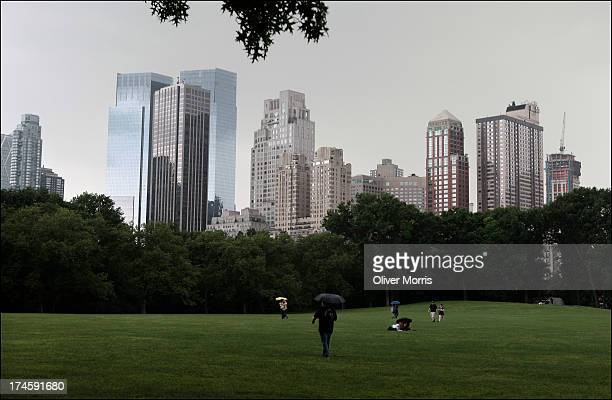 A view of the Manhattan skyline as seen from Sheep Meadow in Central Park a 842 acre public park designed by architects Frederick Law Olmsted and...