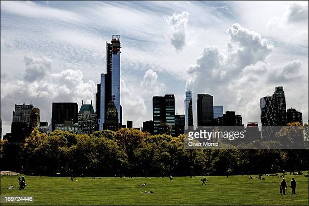 View of the Manhattan skyline as seen from Sheep Meadow in Central Park Manhattan New York New York May 7 2013 The 842acre public park was designed...