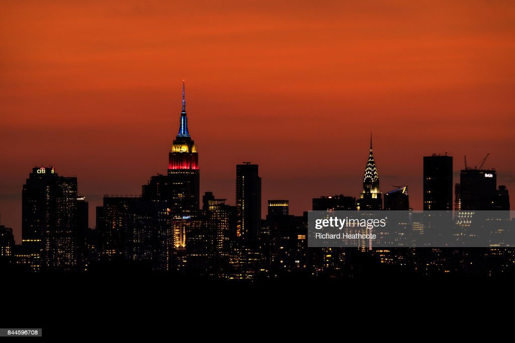 A view of the Manhattan skyline including the Empire State Building and the Chrysler Building at sunset as seen from the Arthur Ashe Stadium on September 03, 2017 in New York City.