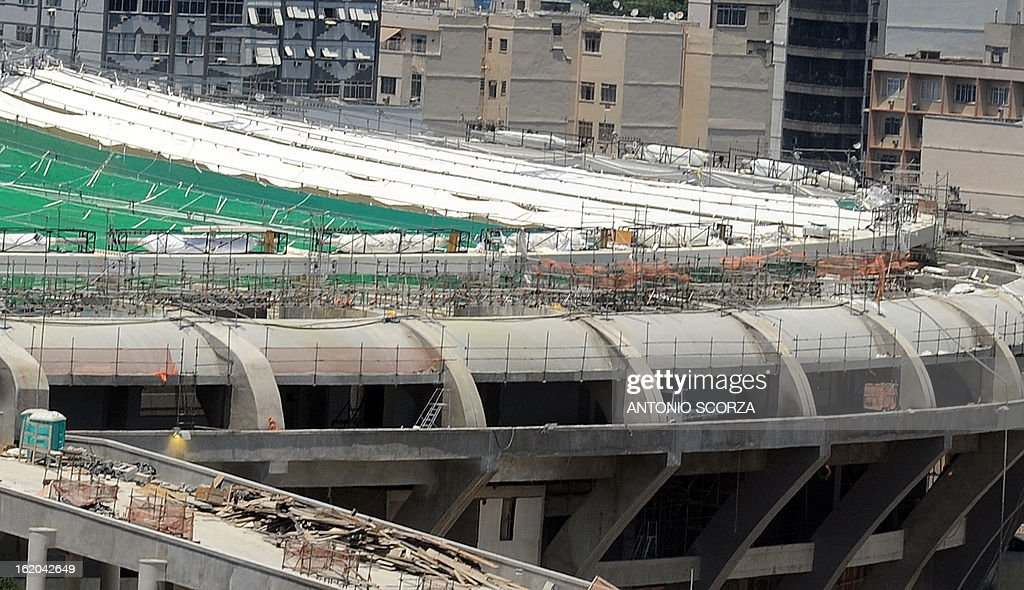 View of the Maracana stadium under renovation works, during a workers' 24-hour warning strike on February 18, 2013 in Rio de Janeiro. The workers -who demand better salaries-- will hold a meeting with the constructors on February 21. The Maracana stadium will host some of the FIFA 2014 World Cup matches in Brazil, including. AFP PHOTO ANTONIO