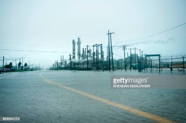 TOPSHOT A view of the Marathon Texas City Refinery as rain from Hurricane Harvey floods a road on August 26 2017 in Texas City Texas Hurricane Harvey...