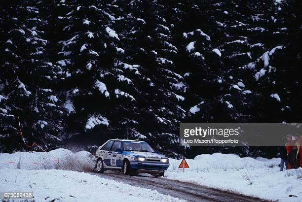 View of the Mazda 323 4WD rally car of the Mazda Rally Team Europe team driven by Finnish rally driver Hannu Mikkola in snow during competition in...