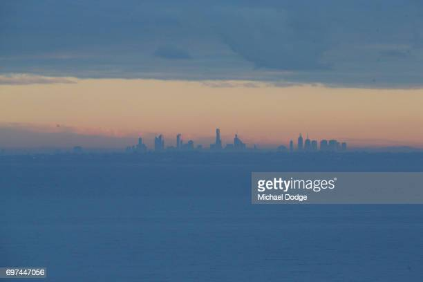 A view of the Melbourne city skyline is seen from Olivers Hill in Frankston as fog slowly clears during sunrise on June 19 2017 in Melbourne Australia