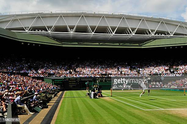 View of the men's singles final match between Switzerland's Roger Federer and Britain's Andy Murray on Centre Court on day 13 of the 2012 Wimbledon...
