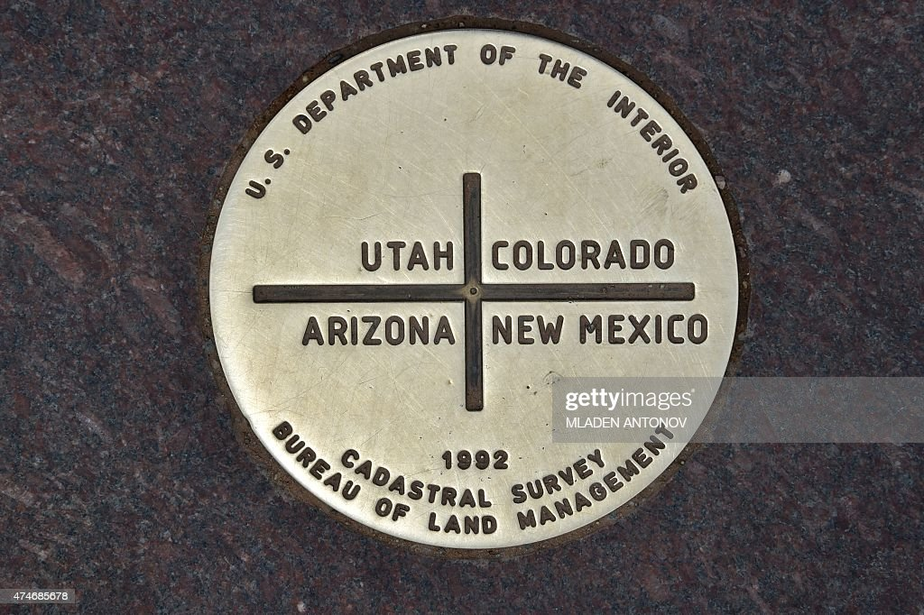 A View Of The Metal Disc Representing The State Line Survey Marker - Colorado location in us