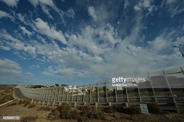 View of the Mexican town of Tijuana from the US side of the border and showing the fence that divides the two countries in San Diego on August 20...