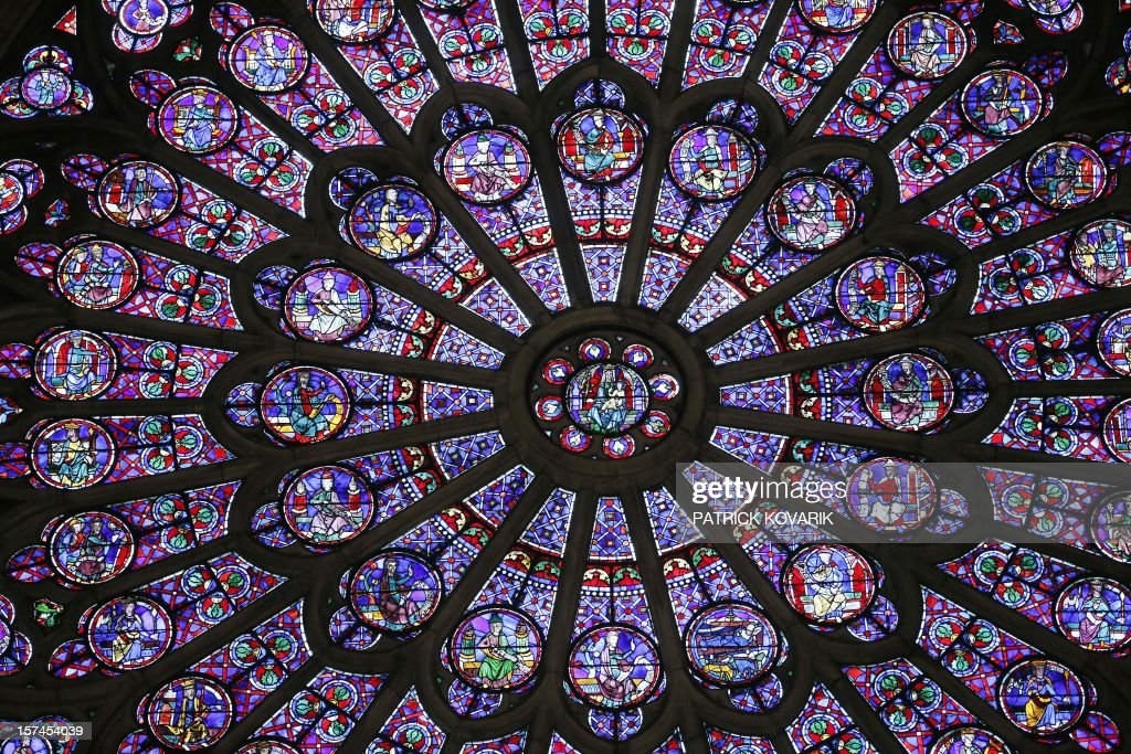 A view of the middle-age stained glass rosace on the northern side of the Notre-Dame de Paris cathedral, on November 29, 2012, in Paris.