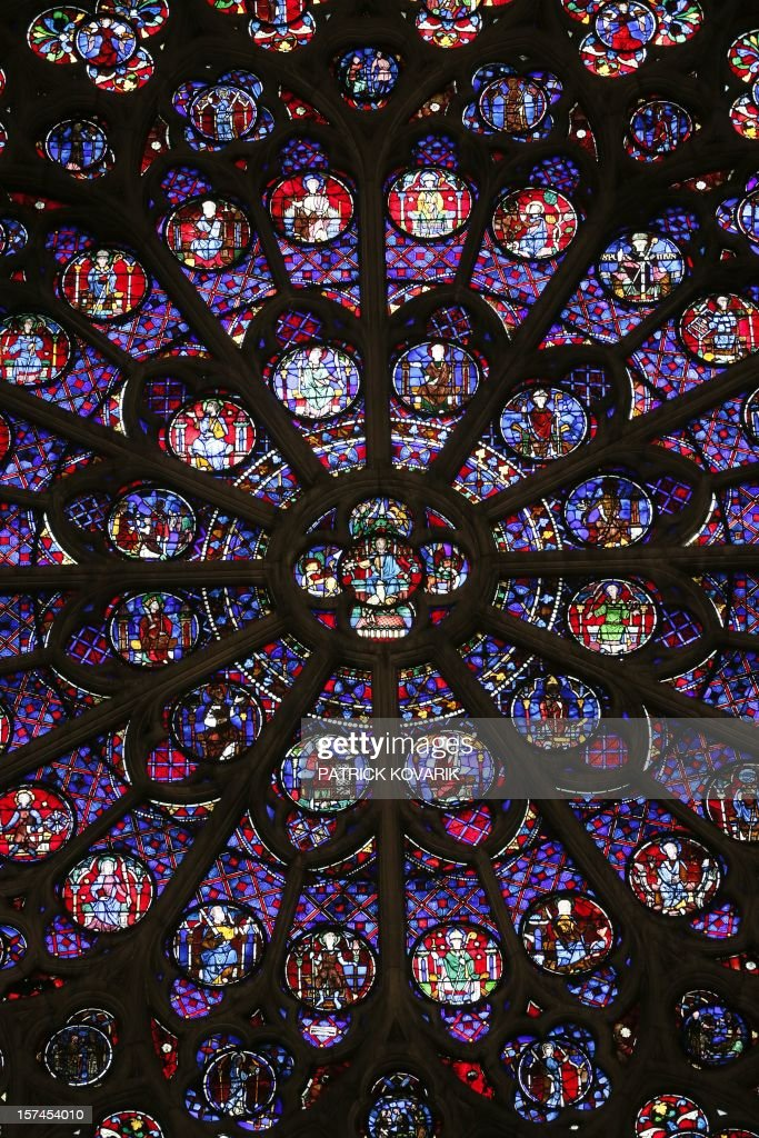 A view of the middle-age stained glass rosace on the southern side of the Notre-Dame de Paris cathedral, on November 29, 2012, in Paris.