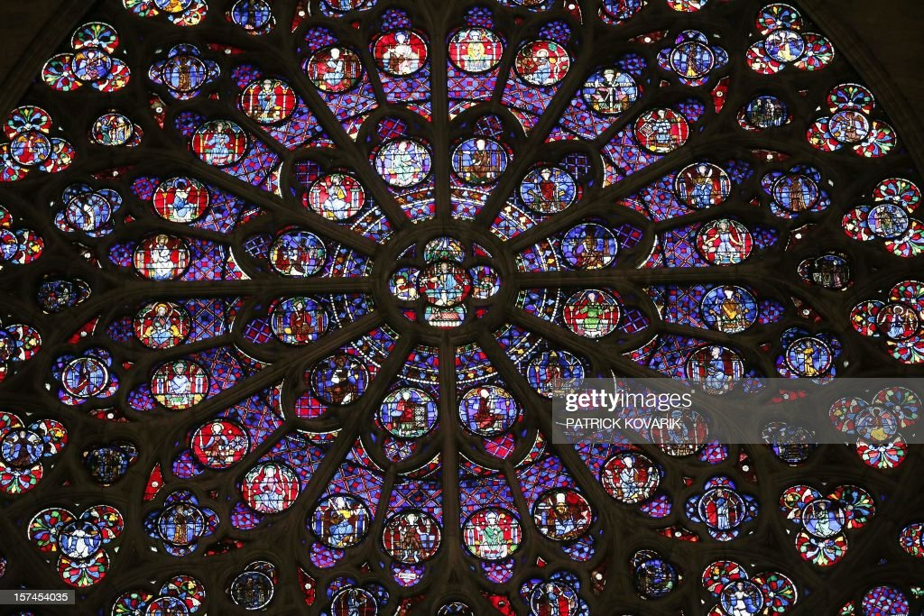 A view of the middle-age stained glass rosace on the southern side of the Notre-Dame de Paris cathedral, on November 29, 2012, in Paris. AFP PHOTO / PATRICK KOVARIK