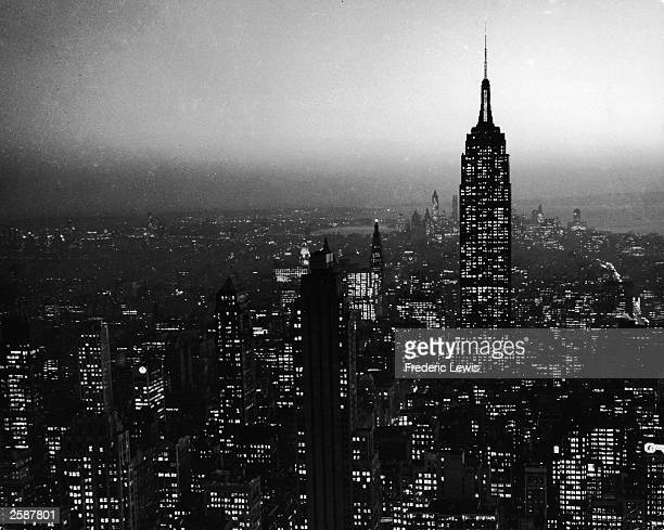 A view of the Midtown New York City skyline and the Empire State Building at night