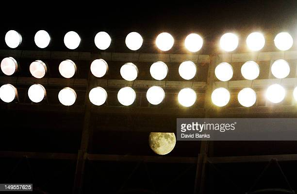 A view of the moon shining through the lights during the game between the Chicago Cubs and the Pittsburgh Pirates on July 30 2012 at Wrigley Field in...