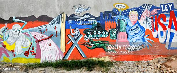 View of the mural paint made by Mexican artist Luis Sotelo called 'We are migrants not criminals' in Tonatico Mexico on 25 June 2016 The mural is...