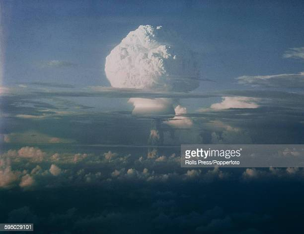 View of the mushroom cloud caused by the detonation and explosion of a thermonuclear weapon or Hbomb during a series of nuclear tests by the United...