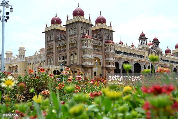 CONTENT] A view of the Mysore palace with flowers