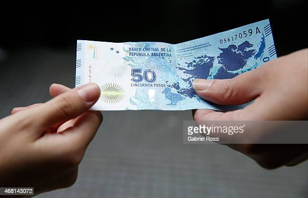 View of the new 50peso bill carrying a map of the Malvinas Islands on March 27 2015 in Buenos Aires Argentina On April 02 1982 Leopoldo Fotunato...