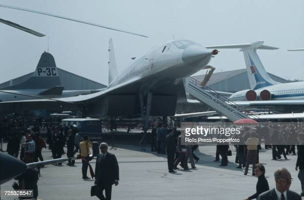 View of the new Soviet built prototype supersonic transport aircraft Tupolev Tu144 nicknamed Concordski surrounded by spectators and guests at Le...