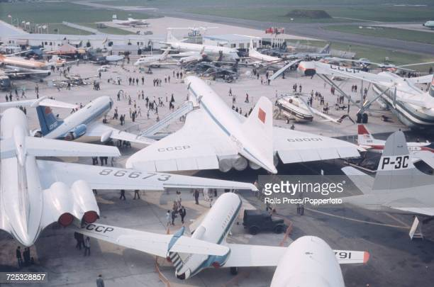 View of the new Soviet built prototype supersonic transport aircraft Tupolev Tu144 nicknamed Concordski surrounded by various other Soviet built...