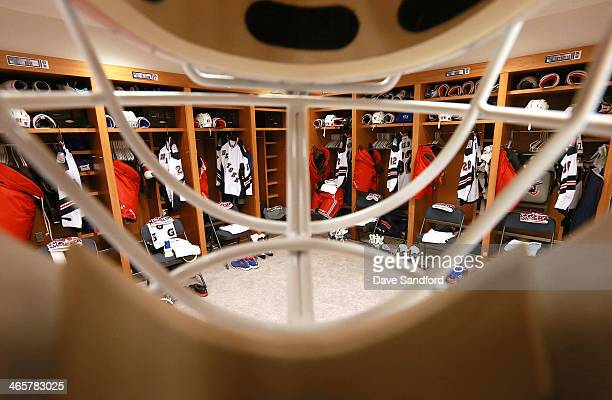 A view of the New York Rangers locker room as seen through a goalie mask prior to the 2014 Coors Light NHL Stadium Series at Yankee Stadium on...