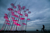 View of the Nikos Zoggolopoulos umbrellas with pink illumination as part of 'Pink October' in support for breat cancer campaign on October 21 2015 in...