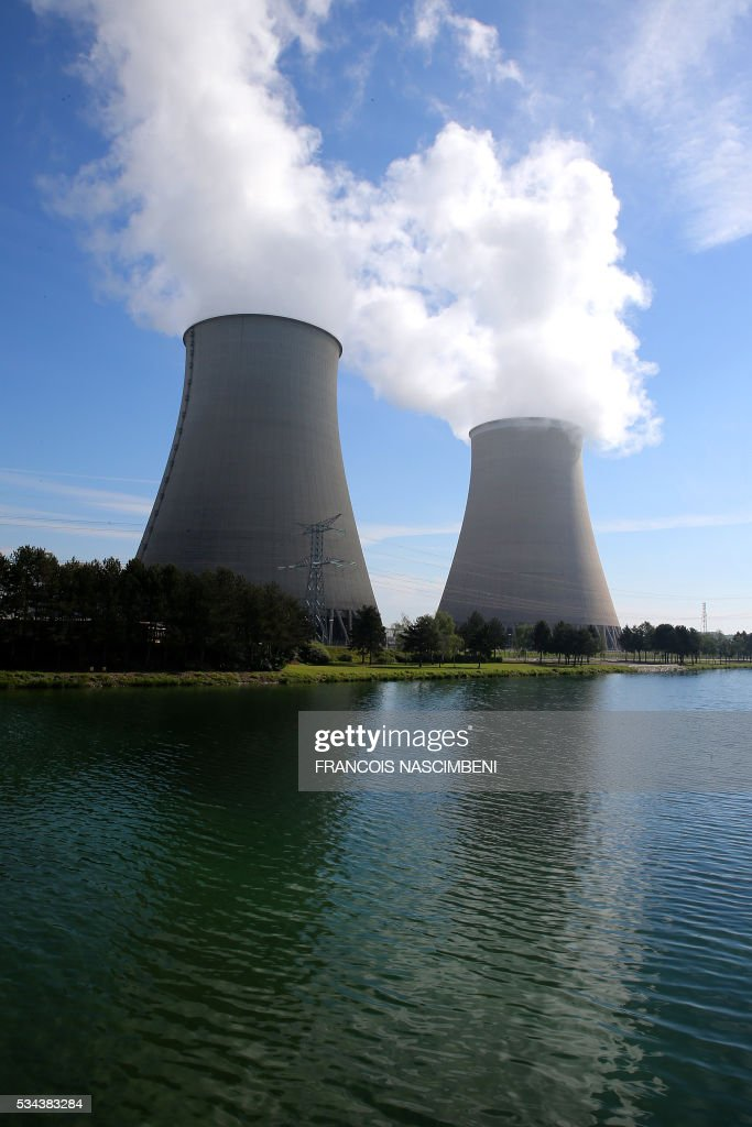 A view of the Nogent nuclear power plant at Nogent-sur-Marne, east of Paris seen on May 26, 2016, where workers have gathered to protest against controversial labour market reforms that has already severely disrupted fuel supplies. With two weeks until France hosts the Euro 2016 football championships, the country has been paralysed by a series of transport strikes and fuel shortages that has heaped pressure on the deeply unpopular Socialist government. / AFP / FRANCOIS