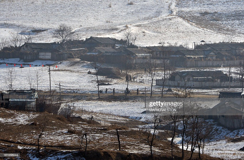 View of the North Korean town of Ch'ongsudong-Chung-ni taken from the Chinese town of Hekoucun on February 9, 2013. US Secretary of State John Kerry warned that North Korea's expected nuclear tests only increase the risk of conflict and would do nothing to help the country's stricken people. The country has vowed to carry out a third nuclear test soon, and concerns have been raised over the type of fissile material used in the device. AFP PHOTO/Mark RALSTON