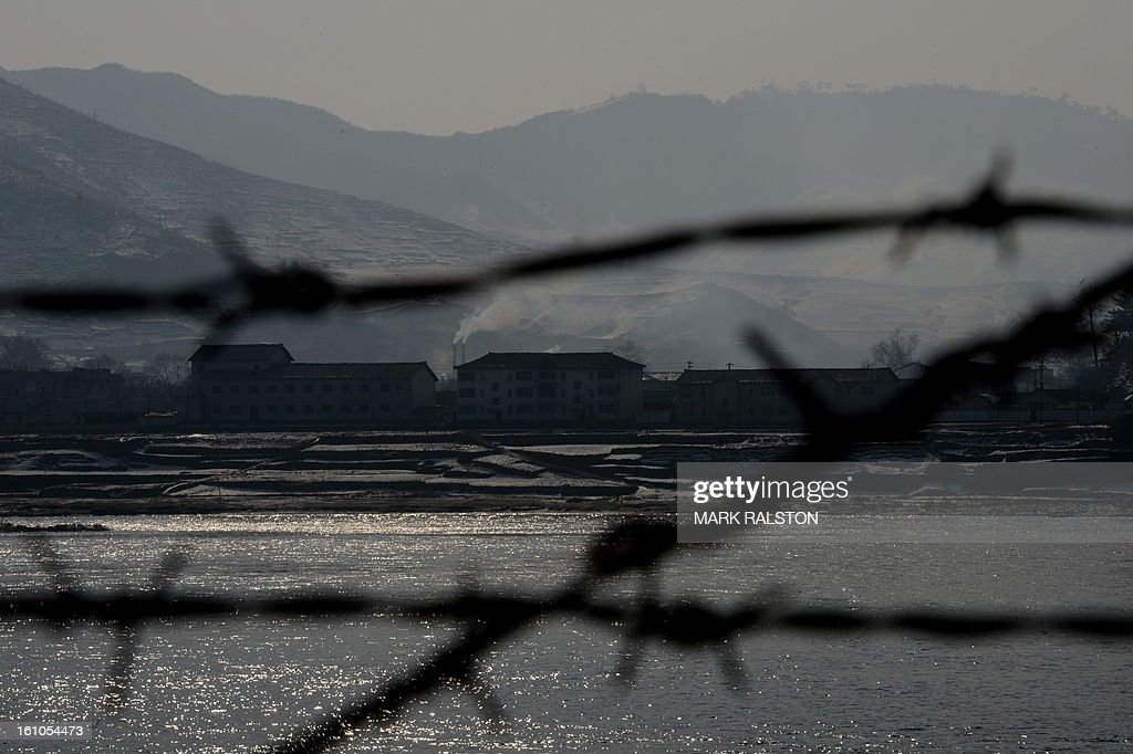View of the North Korean town of Supung across the Yalu River from the Chinese town of Xiejiagou on February 9, 2013. US Secretary of State John Kerry warned that North Korea's expected nuclear tests only increase the risk of conflict and would do nothing to help the country's stricken people. The country has vowed to carry out a third nuclear test soon, and concerns have been raised over the type of fissile material used in the device. AFP PHOTO/Mark RALSTON