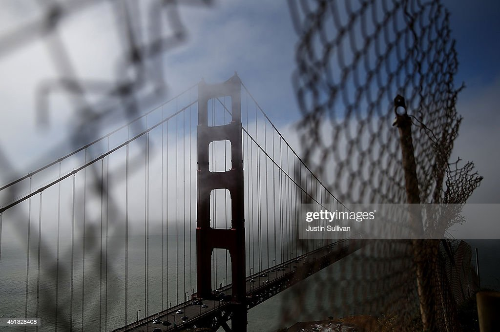 A view of the north tower of the Golden Gate Bridge on June 27, 2014 in Sausalito, California. The Golden Gate Bridge district's board of directors voted unanimously to approve a $76 million funding package to build a net suicide barrier on the iconic span. Over 1,500 people committed suicide by jumping from the iconic bridge since it opened in 1937. 46 people jumped to their death in 2013.