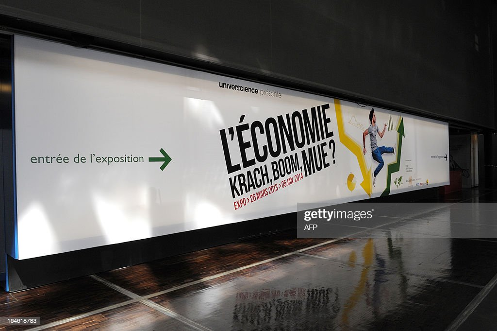 View of the official poster taken on March 25, 2013 prior to the opening of the exhibition 'L'Economie: krach, boom, mue ?' at the Cite des Sciences in Paris. AFP PHOTO/ ERIC PIERMONT