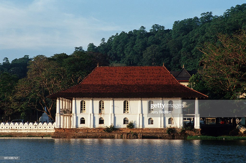 A view of the old British Barracks building in the complex housing The Temple of the Tooth in Kandy. The important Buddhist shrine is believed to hold one of the Buddha's teeth. In the past, it has been the target of Tamil Tiger bombing attacks, though the keepers say the Buddha relic itself was not damaged..