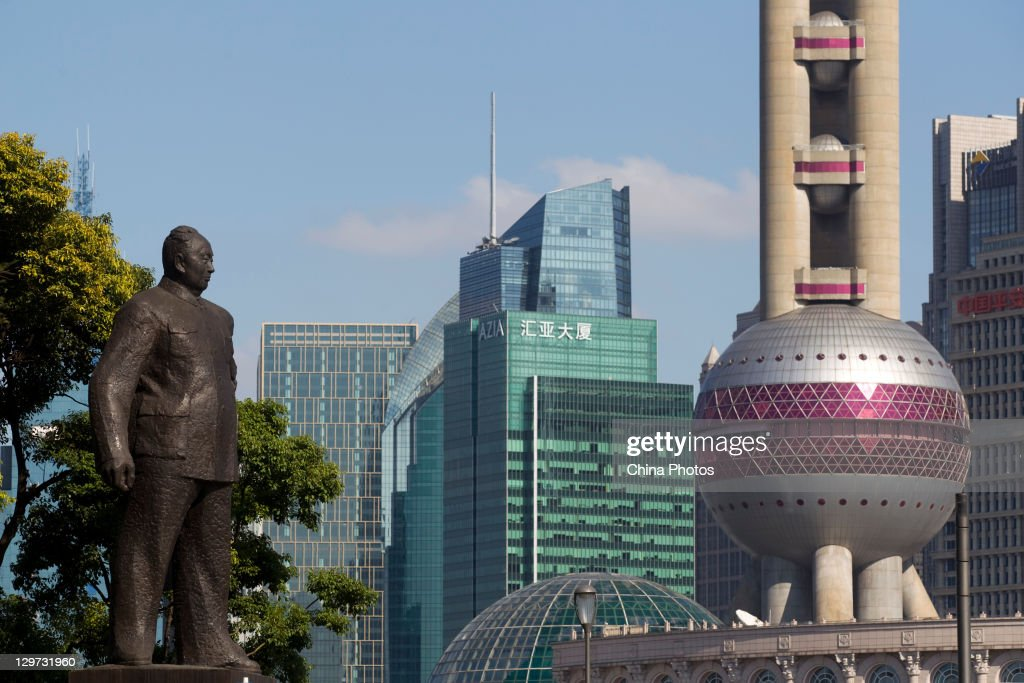A view of the Oriental Pearl Tower and skyscrapers in the Lujiazui Financial District is seen opposite the Waterfront Bund on October 19, 2011 in Shanghai, China. The financial hub has entered late autumn, one of the best seasons for tourism. .