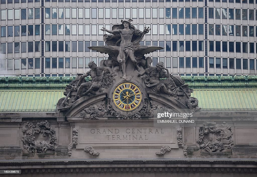 A view of the outside clock of Grand Central Terminal in New York, January 29, 2013. Grand Central, the doyenne of US train stations, is celebrating its 100th birthday on February 2, 2013. Opened when trains were a luxurious means of traveling across The US, the New York landmark, with its Beaux-Arts facade, is still one of the US largest transportation hubs and is also New York's second-most-popular tourist attraction, after Times Square. AFP PHOTO/Emmanuel Dunand
