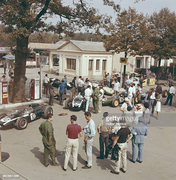 A view of the paddock as the and Cooper Climax Climax V8's of Jack Brabham and Bruce McLaren along with the Team Lotus Lotus 18/21 of Innes Ireland...
