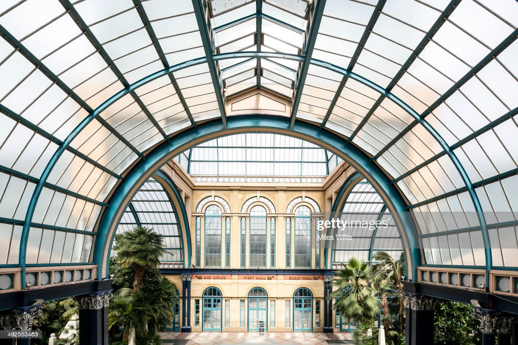 A view of The Palm Court roof at Alexandra Palace on May 16, 2014 in London, England. Alexandra Palace situated in the London Borough of Haringey First opened as 'The PeopleÕs Palace' in 1873. Just 16 days later a fire broke out in the Palace, burning it down in its entirety. On 2 November the world's first regular high-definition public television broadcast took place from the BBC studios at Alexandra Palace. In 1980 fire again burned a large part of the building, the Palace reopened in 1988. Recently awarded a Round 1 pass from The Heritage Lottery Fund the Palace plans to renovate parts of the derelict building including the BBC Studios and Victorian Theatre.