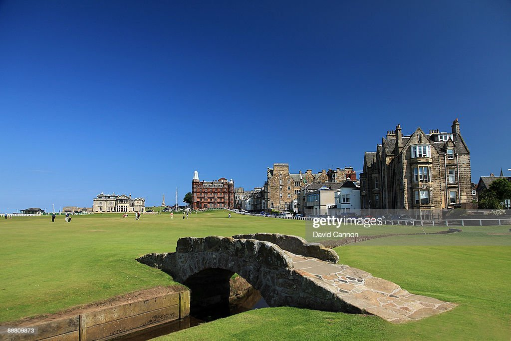 A view of the par 4 18th hole with the Royal and Ancient Golf Club of St Andrews Clubhouse and the Swilcan Bridge on the Old Course on July 2 2009 in...