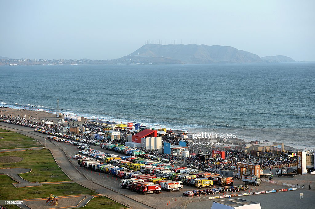 View of the parking lot of the Dakar 2013 competition at a beach in Magdalena, Lima on January 4, 2012. The 2013 Dakar Rally will feature 459 vehicles -- cars, bikes, trucks and quads -- and will cover 8,400km of Peru and Chile, with a stay in Argentina.