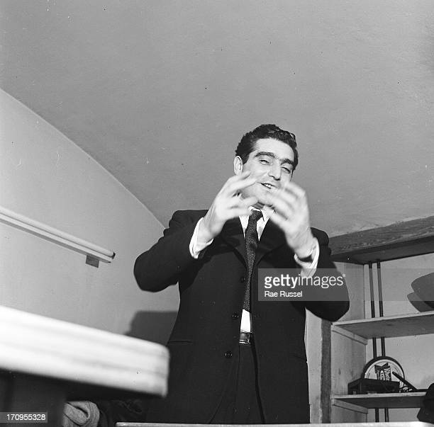 View of the photographer Robert Capa attending a meeting of the American Society of Media Photographers New York 1948